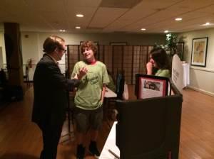 High School students Brandon Fiocco-Mizer and Kyrsten Brewis talk with Next Gen Board Member, Hall Chaney.